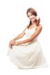 Lovely woman in sundress against white background