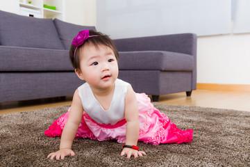 Little girl creeping on carpet