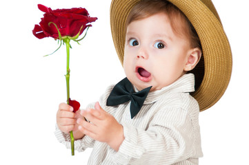 Emotional pretty baby gentleman with a rose in his hand.