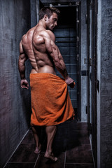 Muscular young sexy guy wrapped in a towel