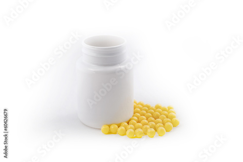Prescription spilled, pills yellow vitamiins