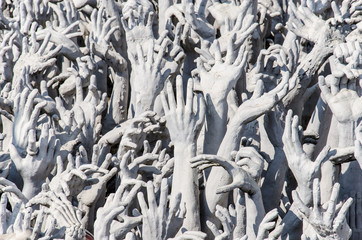 Hand from hell of Wat Rong Khun temple in  Thailand