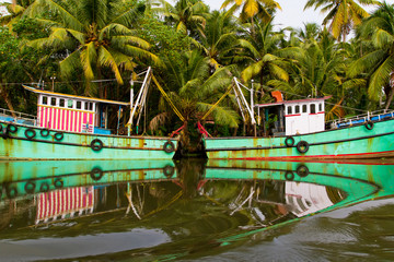 Indian fishing-boats with beautiful reflections in the water