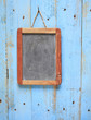 blank old black board, on weathered wooden wall,free copy space