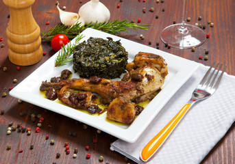 baked rabbit with vegetables in a dish