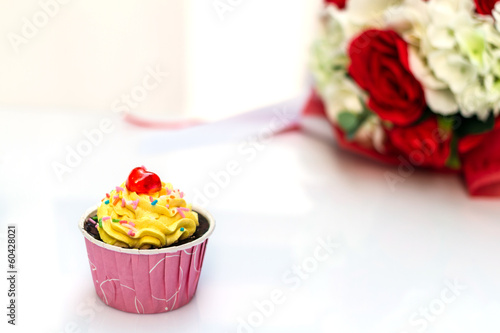 Chocolate cake and roses on white background