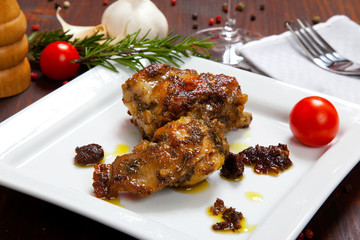 baked rabbit with tomatoes in a dish
