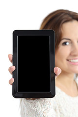 Woman hand holding and showing a blank tablet pc screen