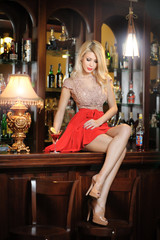Attractive blonde woman with long hair in elegant dress