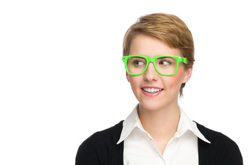 Beautiful young woman in green glasses looking at copy space.