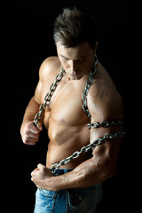 Handsome and muscular young guy with chain