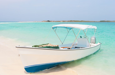 White boat at the beach of archipelago Los Roques, Venezuela