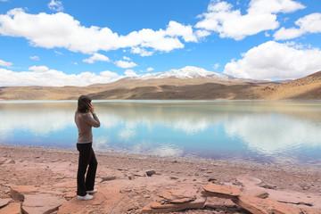 Woman talking on mobile phone at lagoon Celeste