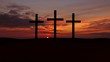 Three crosses on a hill with red  sunset.