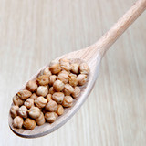 chickpeas, vegetables on a wooden spoon