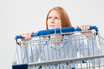 Sad Woman with Shopping Cart