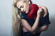 Lovely Beautiful Blond Woman with Red Heart.Saint Valentine Day