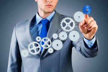 businessman touch the mechanism