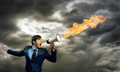 businessman shouting into a megaphone