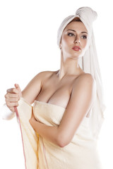 young pretty girl posing with a towel on white background