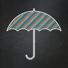 Safety concept: Umbrella on chalkboard background