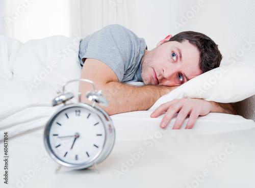 Leinwandbild Motiv man in bed with eyes opened suffering insomnia disorder