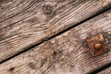 Old Rotten Planks With Rusty Nails And Square Washer With Screw