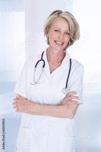 Portrait Of Happy Mature Female Doctor