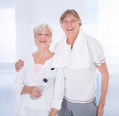 Senior Couple With Towel And Water Bottle