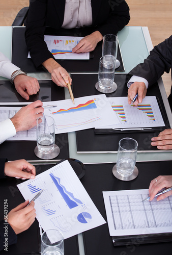 Group Of Businesspeople Discussing Plan In Office