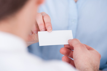 Businesspeople Exchanging Visiting Card
