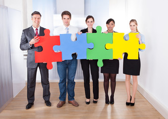 Businesspeople Assembling Jigsaw Puzzle