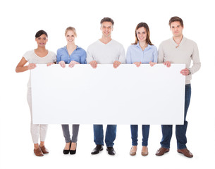 Group Of People With Billboard