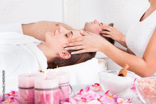 Young Couple Enjoying Massage