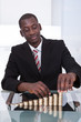 Businessman Stacking Coins