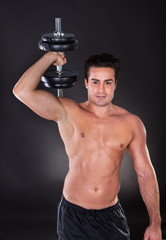 Man Exercising Dumbbells
