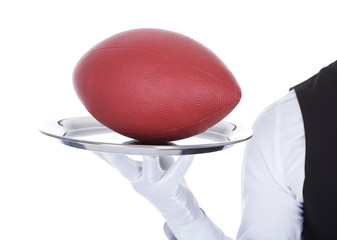 Waiter Carrying Rugby Ball