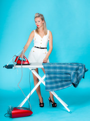 girl retro ironing shirt, woman housewife in domestic role.