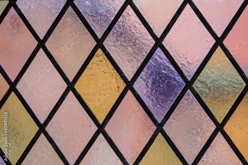 Obraz na Plexi Stained glass with multi colored diamond pattern as background