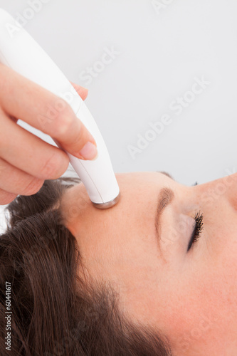 poster of Woman Under Going Microdermabrasion Treatment