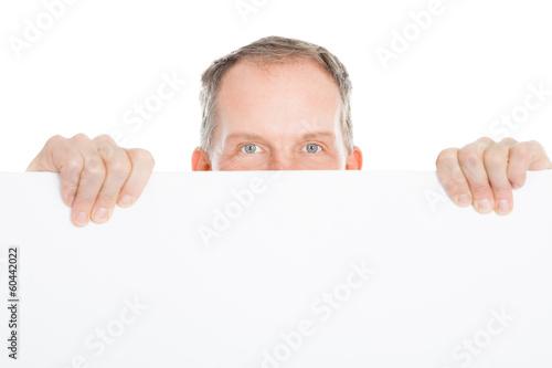 Mature Man Holding Placard