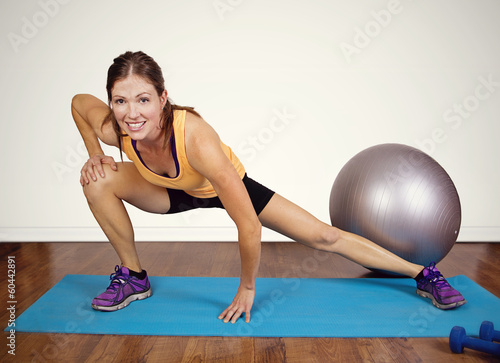 Fit woman stretching before a workout