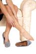 Woman black skirt rub leg one shoe off