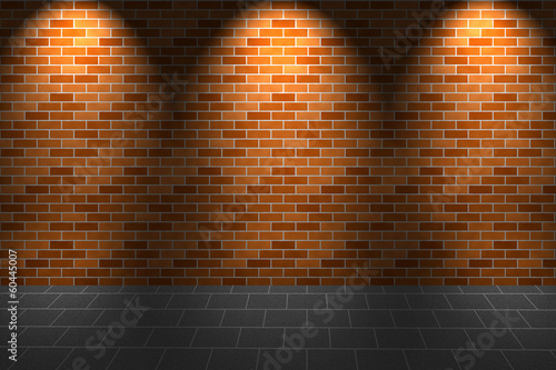 Fragment of light on orange brick wall and floor