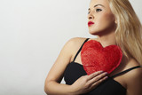 Lovely Beautiful Blond Woman with Red Heart. Love Symbol