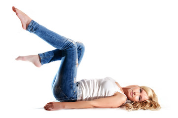 beautiful young blond woman in jeans and a white T-shirt