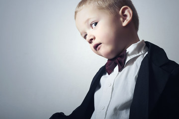 Funny Little Boy in Black Suit.4 Years Old Child in Bow tie