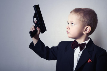 Little James Bond.Child in Suit.Agent.Handsome Boy with Gun