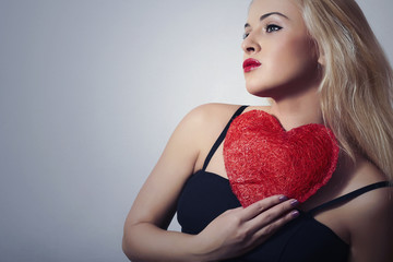 Lovely Beautiful Blond Woman with Red Heart.Symbol of Valentine