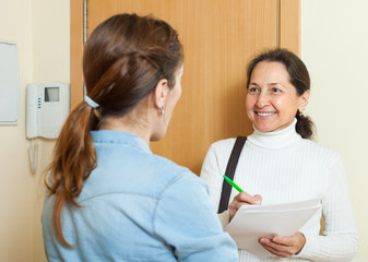 woman filling questionnaire for mature employee